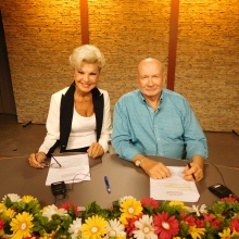 Co-hosts Yolanda Cellucci and Justin Barrett present auction items during a thirty minute segment.