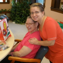 Mary Ann Monette and Volunteer Michaela Baron enjoy one another's company.