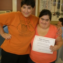 Jessica Crisafulli congratulates Sheila Hernandez for once again earning recognition for perfect attendance.