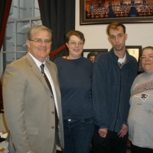 Representative Thomas Stanley (left) meets with (l to r) Kristina Smith, Adam Maher and Ruth Powers in his office at the Massachusetts State House.
