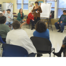 Participants ask questions at a CEO Town Meeting with Roz Rubin at Woodland Road.