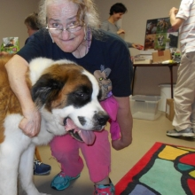 Yolande Nowlan visits with a friend while volunteering at Phinney's Friends, a non-profit dedicated to helping people feed and care for their pets.