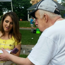 GWArc participant Brian Doucette gets an autograph from Fox 25 meteorologist Shiri Spear during Fox News 25's Zip Trip to Waltham.
