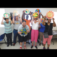 GSE participants show off their art work created in sessions with Artist Dan Dressler.
