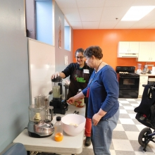 Cindy works with Chef Reva of Healthy Waltham to prepare a healthy meal at Chestnut Street.