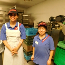 Jen and Joseline work in the dish room at a Brandeis University dining hall.