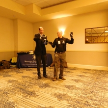 Adam Maher, GWArc Board Member, helps Ken Doucette of the Middlesex Sheriff's Office with a demonstration during the Keynote Presentation at GWArc's Annual Meeting.