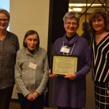 Representatives of the Jones Partnership Fund of First Parish in Waltham receive GWArc's Outstanding Community Leadership Award. Left to right: Alice Taylor, Marianne Cutter, Amy Eastwood and Roz Rubin, GWArc CEO.
