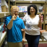 Eddie and Roxie deliver groceries to the Salvation Army food pantry.