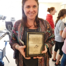 Siobhan O'Connell, McDevitt Middle School teacher and organizer of student visits, receives an appreciation plaque from GWArc.