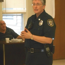 Officer Ann Frassica discusses bomb threats at the March meeting.