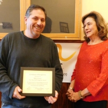Mike Grimes, Day Habilitation Case Manager, accepts his five year longevity award from Roz Rubin, CEO.