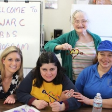 Making Valentine crafts with Bentley Service-Learning student      volunteers was a fun February project.