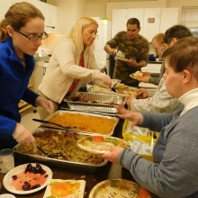 Staff members and volunteers serve a delicious pre-Thanksgiving dinner to CBDS and GSE  participants at Woodland Road in November.