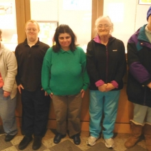 CBDS participants gather in front of the Artists of GWArc art display they helped set up at the Waltham Public Library.