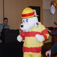 Sparky, the Waltham Fire Department mascot, lights up the dance floor.