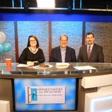 Kelly Hill and Rick Pizzi speak with David Gurwicz (right), manager of Ruth's Chris Waltham, during the live TV auction. Ruth's Chris donated several auction items.