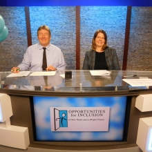 Phil McGrady of WCAC TV and Samantha George of Embassy Suites Waltham co-host a Live TV Auction segment.