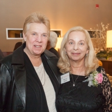 Honoree Mary Leo celebrates her award with a friend.