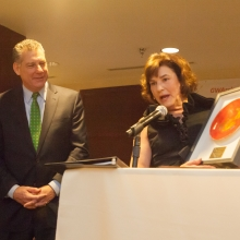 CEO Roz Rubin presents honoree Sheriff Peter Koutoujian with a framed pottery piece by the Artists of GWArc.