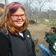 Kali Reynolds learning about wolves on a Recreation trip to Wolf Hollow.