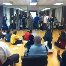 Participants enjoy a performance by a Brandeis acapella group during a Brandeis Buddies meeting.
