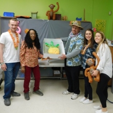 Participants enjoyed a luau party at Chestnut Street on April 26, 2016! Day Hab Case Managers Rhonda Fleming and Mike Grimes pose with Bentley Service Learning students before serving cupcakes.